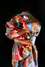 Woman Holds A Patchwork Bedspread.