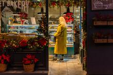Senior Woman From Back Shopping At Bakery