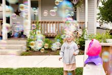 Girl In Sunglasses With Bubble Machine