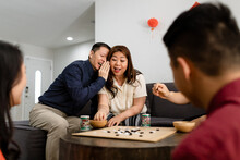Chinese Family Plays A Game During Chinese New Year