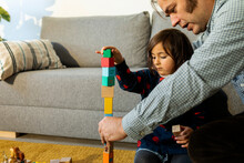 FATHER AND DAUGHTER PLAYING With Building Blocks