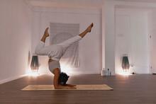 Woman Training Yoga Alone