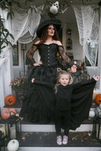 Mother Witch And Daughter Bat At Halloween
