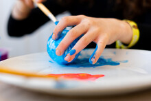 Little Girl Painting The Planet Earth With Brush