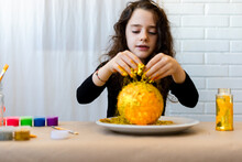 Girl Putting Golden Glitter At Solar System Science Project
