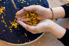 Top View Of Child Hands With Gold Stars Glitter