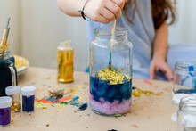 Little Girl Doing Crafts Mixing Colors And Textures At Home
