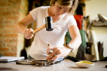 Woman Uses Tools To Set Grommet