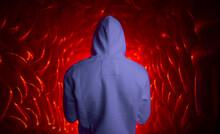Man In Hoodie In Red Room
