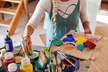 Senior Woman Selecting Paint For Her Artist's Palette