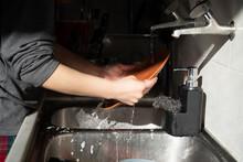 Woman Washing Dishes Wearing Pj