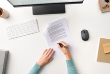 Anonymous Person Signing Contract On Table