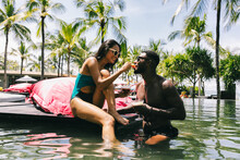 Mixed Race Couple Having Fun By The Pool