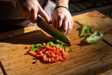 Man Choping Vegetables In Kitchen