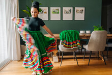 Tween Girl Trying On Her Traditional Mexican Folkloric Skirt At Home