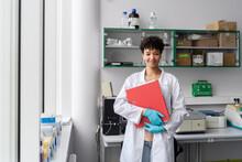 Smiling Scientist Holding Folder
