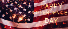 Happy Independence Day USA.  Sparklers And American Flag. Celebration 4th Of July - Patriotic Holiday.