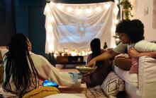 Black Girlfriends Sharing Popcorn While Watching Movie