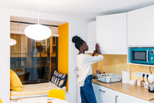 Black Casual Woman Alone In The Kitchen