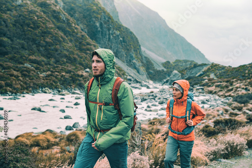 Fotografiet Hiking - hikers on trek with backpacks living healthy active lifestyle