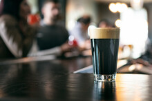 Brewery: Glass Of Rich Stout Beer On Bar