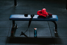Boxing Gloves And Bandages On Bench In Modern Gym