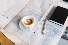 Coffee And Documents On Table