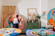 Artist Painting Large-format Round Works In His Studio