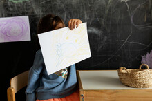 Little Kid Showing The Picture At School Home