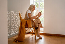 Senior Woman Looking Her Phone At Home
