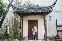A Little Girl In A Chinese Doorway