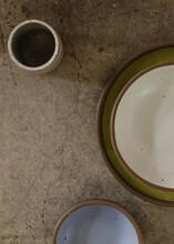 A Set Of Ceramics On A Concrete Surface