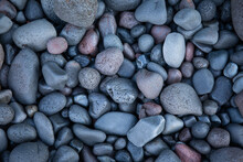Smooth Rocks On The Beach. Amed. Bali.  Indonesia.