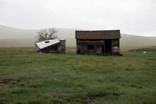 Decrepit Farm Buildings On A Rainy Day