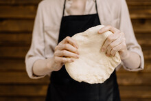 Chef Kneading Dough For Pizza