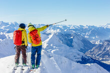 Couple Of Skiers Looking At Mountain View