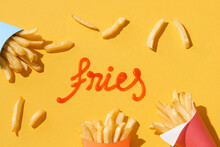 Text Fries Make By Ketchup With French Fries Containers Around