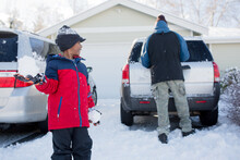 Boy Prepares To Throw Snowball At His Dad