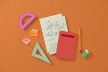 Creative Young Student Desktop With Notebook, Books And Colors, Education, Learning And Childhood Concept