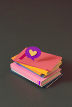 Stack Of Books With Heart Sign