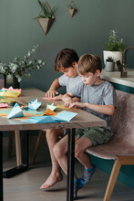 Children Make Crafts Out Of Paper.