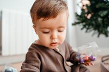Boy Holding Christmas Ornaments