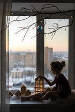Girl With A Lantern On The Windowsill