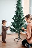 Setting up Christmas tree together.