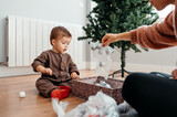 Mom and boy unpacking decorations.