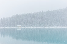 Snow-covered Cabin By Lake Louise In Banff, Alberta