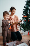 Excited toddler with Christmas bauble.