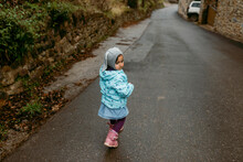 Little Girl Walking On Country Road