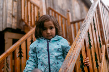Little Girl On Wooden House Stairs