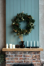 Green Wreath Hanging Above Fireplace At Home